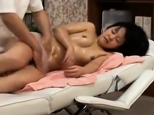She gets a sexy oiled up massage and he goes for her wet cu