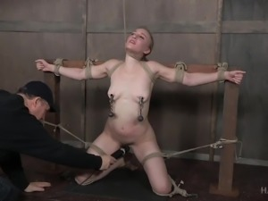 While heavy clamps torture her nipple, this sub's pussy drenches the floor in...
