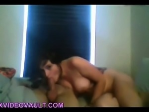 Brunette with big boobs gives a blowjob