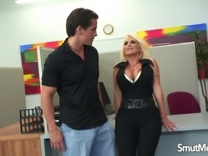 Buxom Blond Cougar Seduces the Office Boy