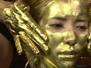 japanese submissive in gold body paint fingers her pussy