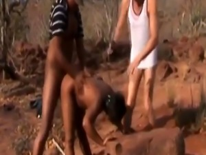 African Slave Gets Double Teamed By Guys Outdoors